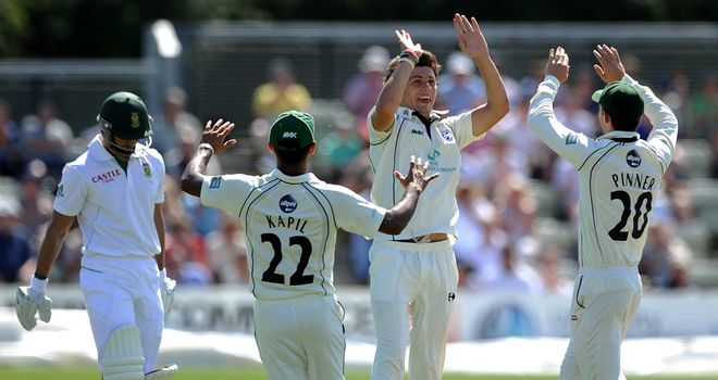 High five: Chris Russell is congratulated after dismissing Alviro Petersen
