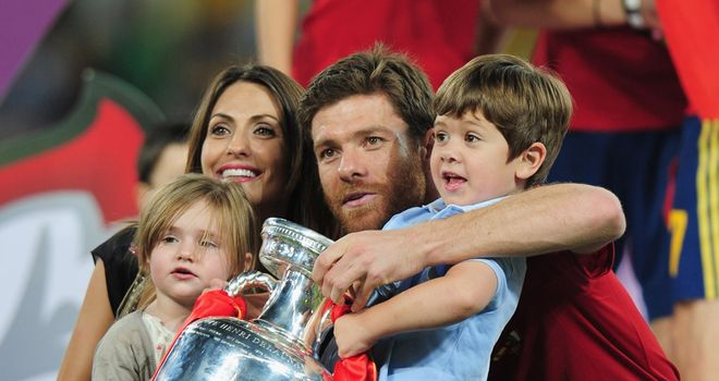 Xabi Alonso: The Real Madrid man celebrates Spain's Euro 2012 win over Italy with his young family
