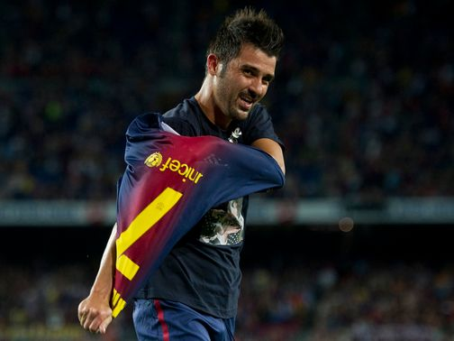David Villa celebrates his comeback goal