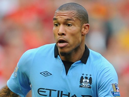 Nigel de Jong: Completes San Siro move