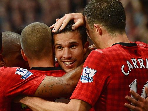 Van Persie celebrates scoring on his first United start