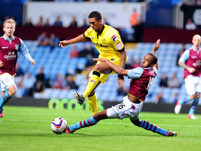 Liam Palmer is tackled by Fabian Delph