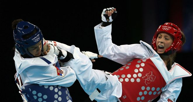 Jade Jones (r) en route to her opening victory