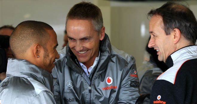 Lewis Hamilton with McLaren chiefs Martin Whitmarsh and Jonathan Neale