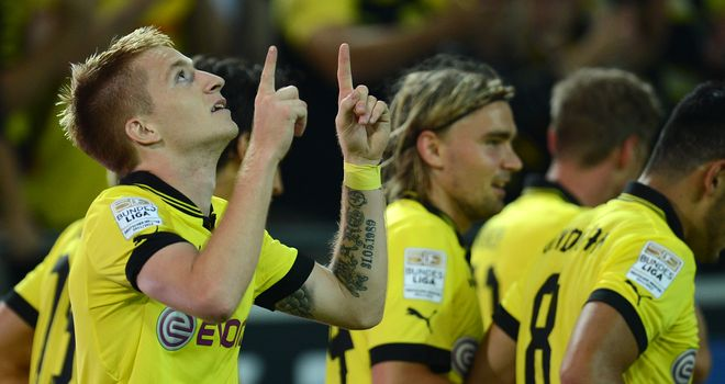 Marco Reus celebrates his opener for Dortmund