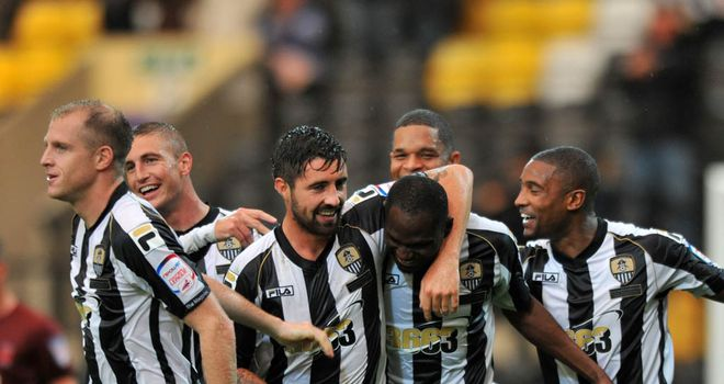 Zoko: Mobbed by his team-mates after scoring for County