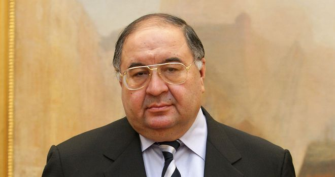 Alisher Usmanov: Feels transfer policy at Arsenal has Arsene Wenger's hands tied