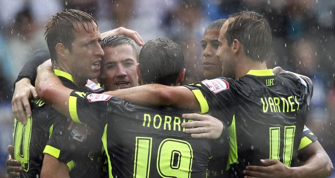 Leeds players celebrate their second goal at Peterborough