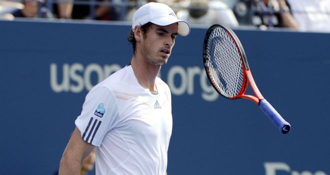 Andy Murray: Bounces his racket after being broken for a third time