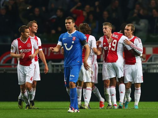 Ajax celebrate Christian Eriksen's winner against FC Twente.