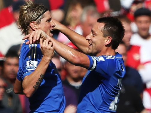 Fernando Torres celebrates with John Terry.