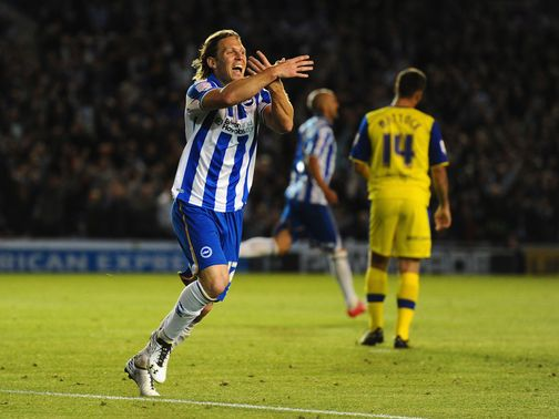Craig Mackail-Smith celebrates his goal