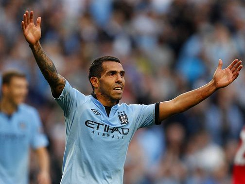 Carlos Tevez celebrates his late goal for City