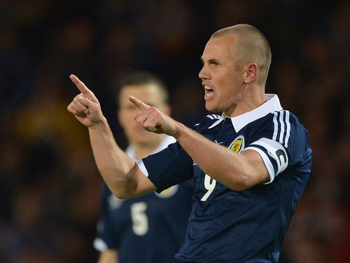 Kenny Miller: Not retiring from Scotland duty