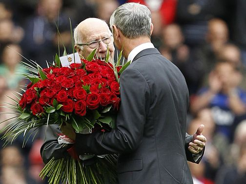 Sir Bobby Charlton presented Ian Rush with flowers