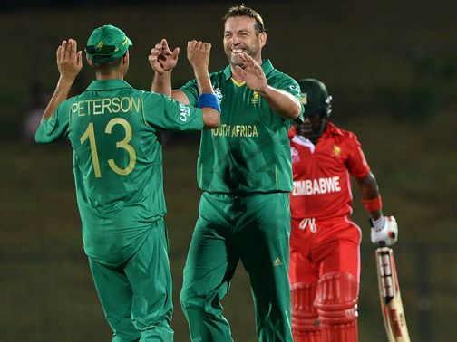 Jacques Kallis: celebrates one of his four wickets as Zimbabwe laboured to 93-8