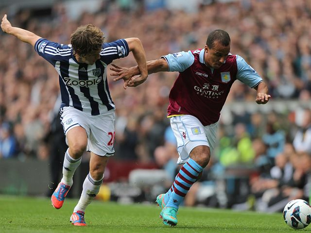 Agbonlahor tries to run away from Jones.