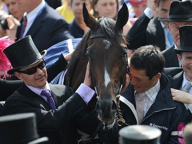 Aidan O'Brien celebrates with Camelot after last year's Derby