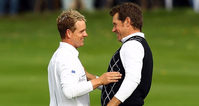 Pair-fect: Europe's Lee Westwood and Luke Donald celebrate foursomes victory in 2010
