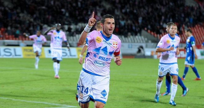 Cedric Barbosa celebrates for Evian