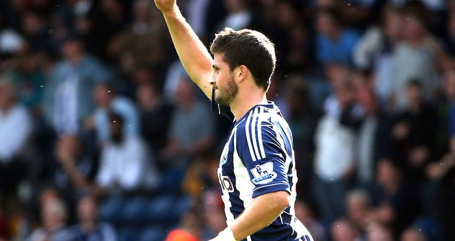 Shane Long: Celebrates his goal and his new manager at the Hawthorns on Saturday