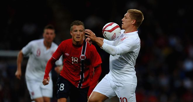 Martyn Waghorn holds off Fredrik Ulvestad as England U21s take on Norway U21s in September