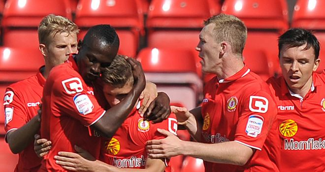 Clayton (c): Striker is congratulated by his team-mates