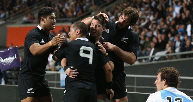 Hat-trick hero Corey Jane is congratulated by his New Zealand team-mates