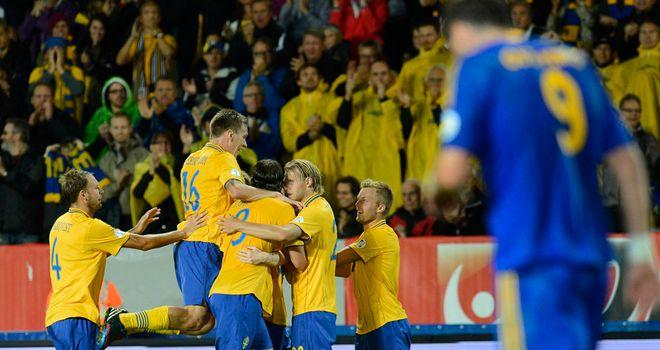 Sweden celebrate Rasmus Elm's goal.