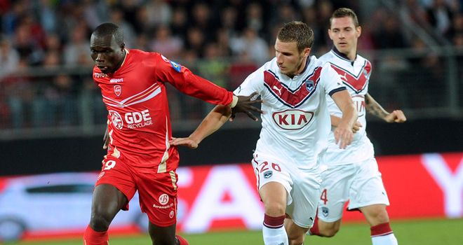 Vincent Aboubakar and Gregory Sertic battle for the ball