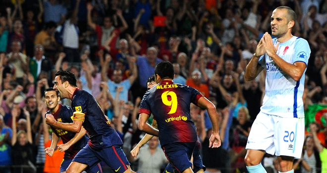 Xavi finally puts Barcelona ahead