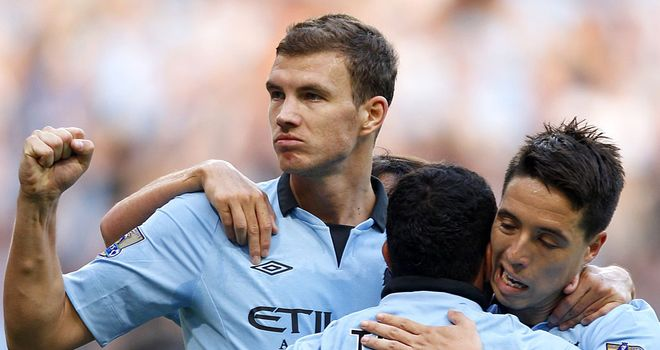 Edin Dzeko: Looking forward to taking on the might of Real Madrid