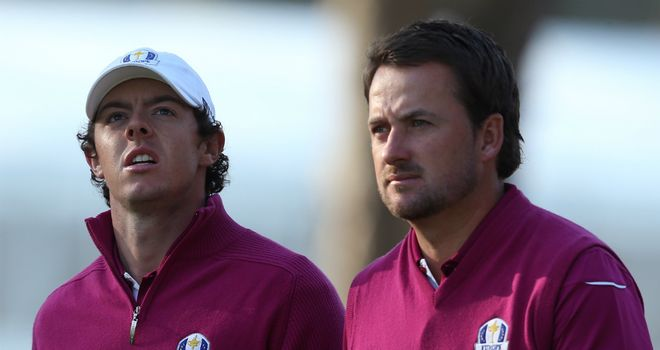 Graeme McDowell (right): Insits World No 1 will overcome his difficulties