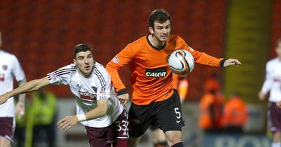 Gavin Gunning: Tries to get clear of Callum Paterson