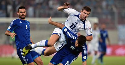 Dzeko double helps sink Greece