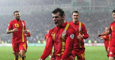 Bale: Celebrates one of his goals for Wales