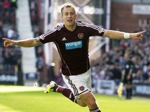 Danny Grainger celebrates his goal for Hearts