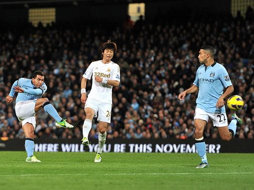 Carlos Tevez scores Manchester City's winner against Swansea.