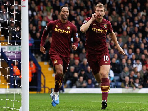 Two-goal Edin Dzeko celebrates at The Hawthorns
