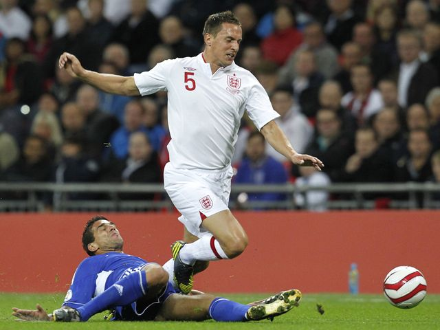 Phil Jagielka takes a tumble.