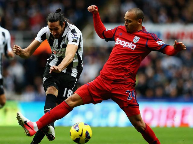 Jonas Gutierrez gets a shot in on goal.