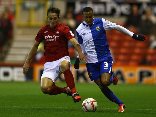Chris Cohen and Martin Olsson battle for the ball