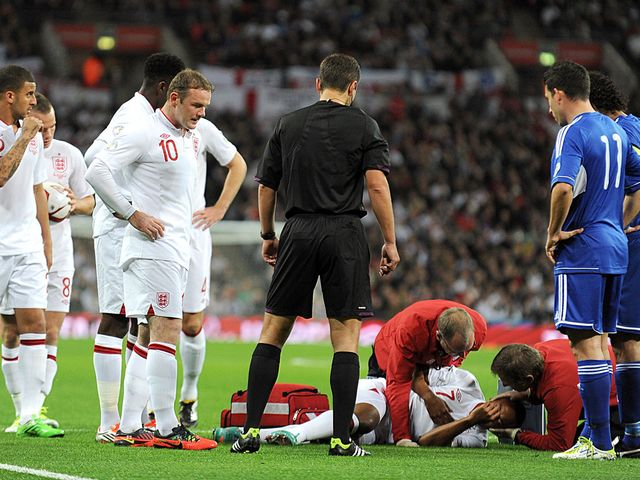 Theo Walcott receives treatment on Friday night.