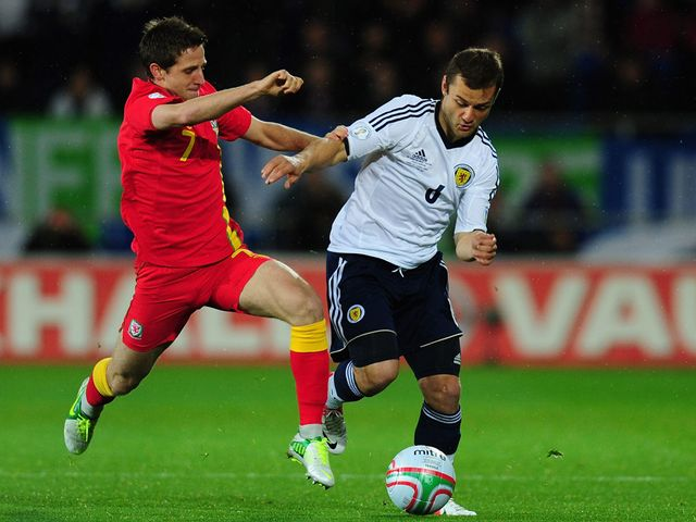 Joe Allen tries to stop Shaun Maloney.