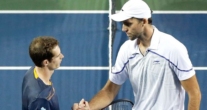 Andy Murray (L): Into second round of Japan Open after victory over Ivo Karlovic
