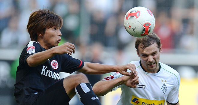 Takashi Inui clashes with Tony Jantschke