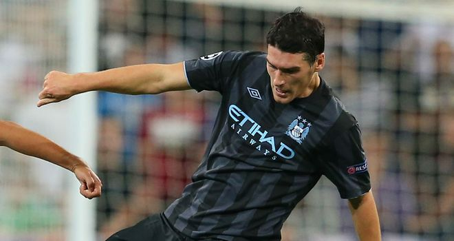 Gareth Barry: Believes Manchester City can still qualify for the last 16 of the Champions League