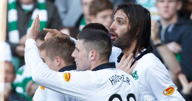 Georgios Samaras (far right) celebrates his goal against Hearts with his Celtic team-mates