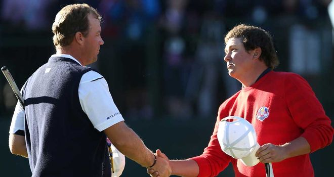 Jason Dufner (R) held on after seeing a four-hole lead drip away