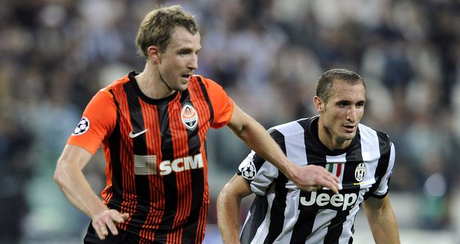 Giorgio Chiellini gives chase alongside Olexandr Kucher